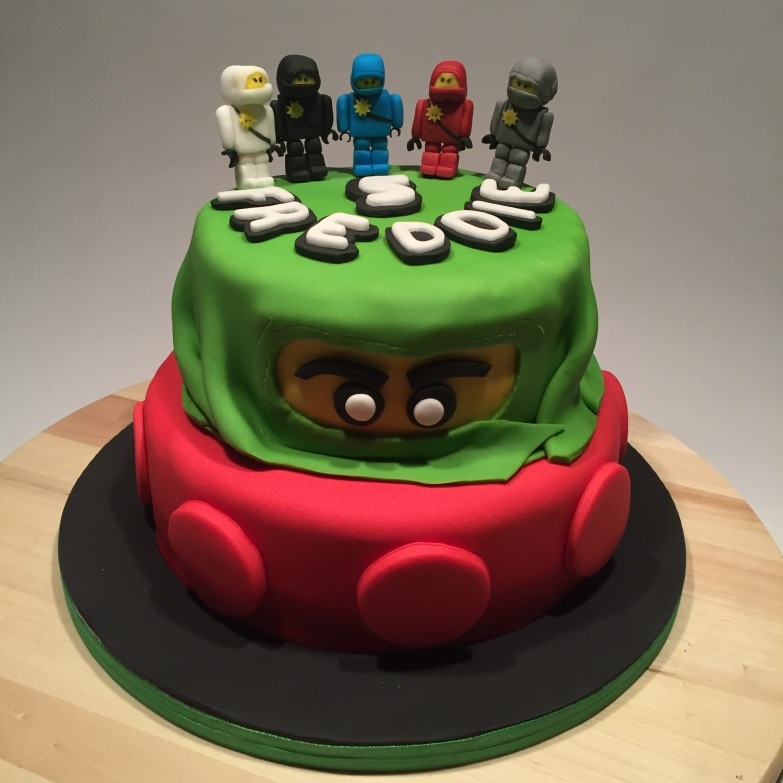 Lego inspired 2-tier cake with 5 sugar paste lego Ninjago figurines