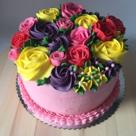 Buttercream flower cake, four layers of raspberry and lemon cakes sandwiches with buttercream