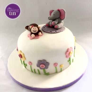 Monkey & Elephant 3 layered baby shower cake. Vanilla cake filled with raspberry jam and buttercream.