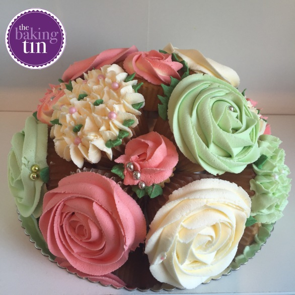 Salmon pink, cream and mint cupcake bouquet